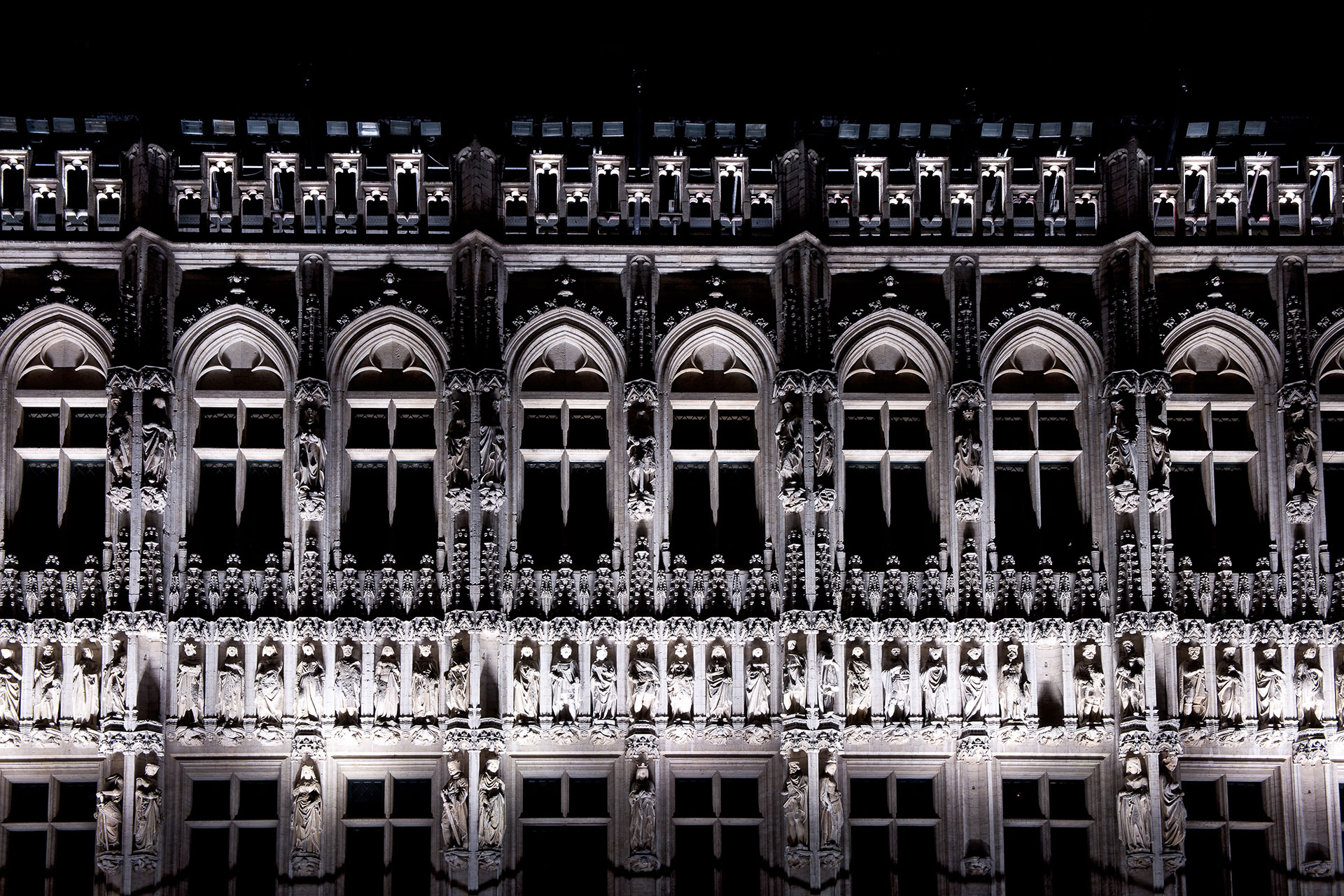 LED floodlights highlight the architectural details of the Gothic façades on Grand Place